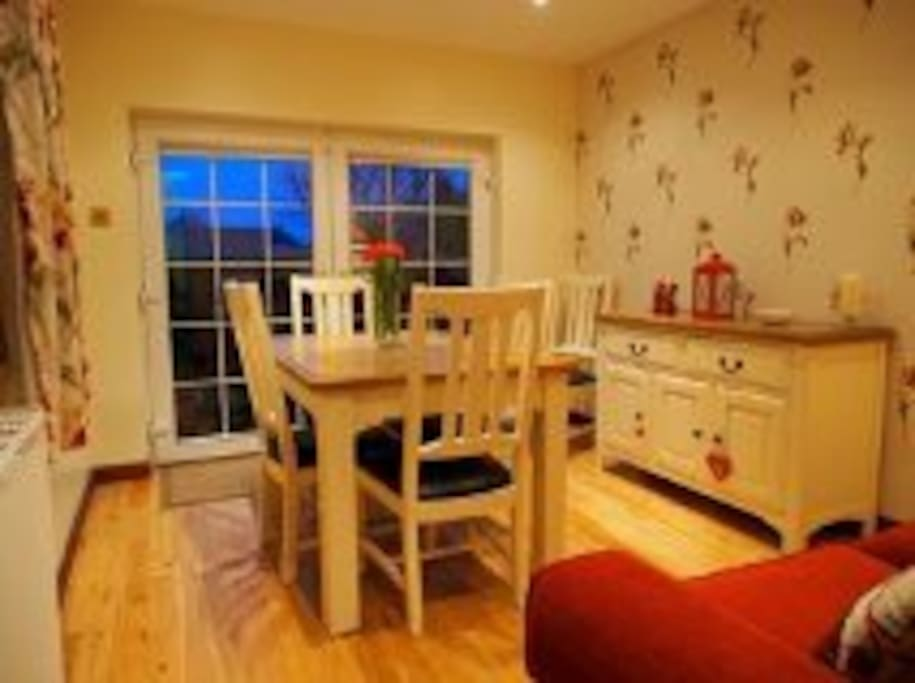 Lovely dual aspect dining room with extendable table.