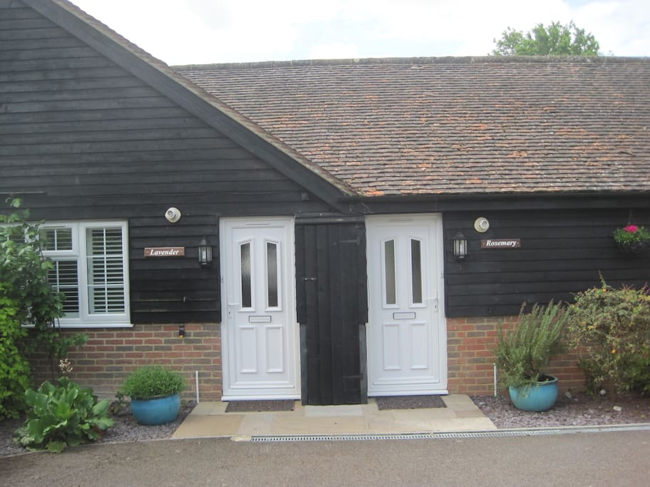Lavender and Rosemary Cottages front doors behind gated entrance