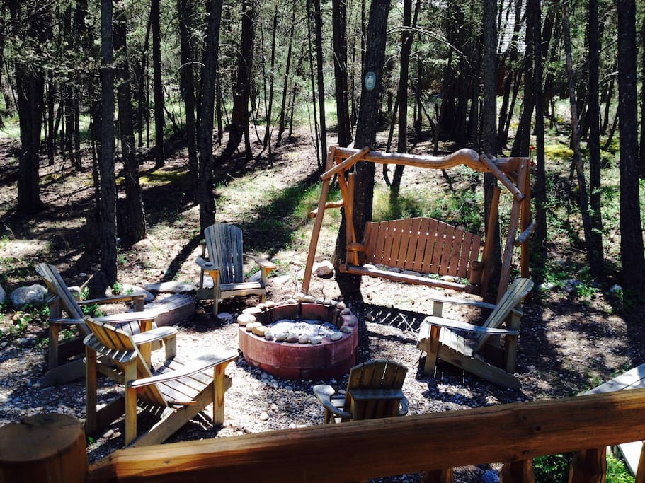 There is a fire pit on the south side of the cabin.