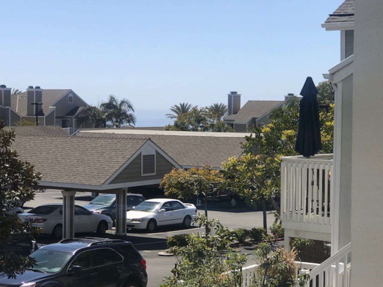 Peek-a-boo ocean view from from front door and kitchen.   One reserved parking spot with ample guest parking.