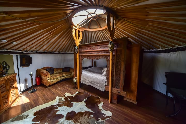 Balinese antique carved bed at Lincoln Yurts