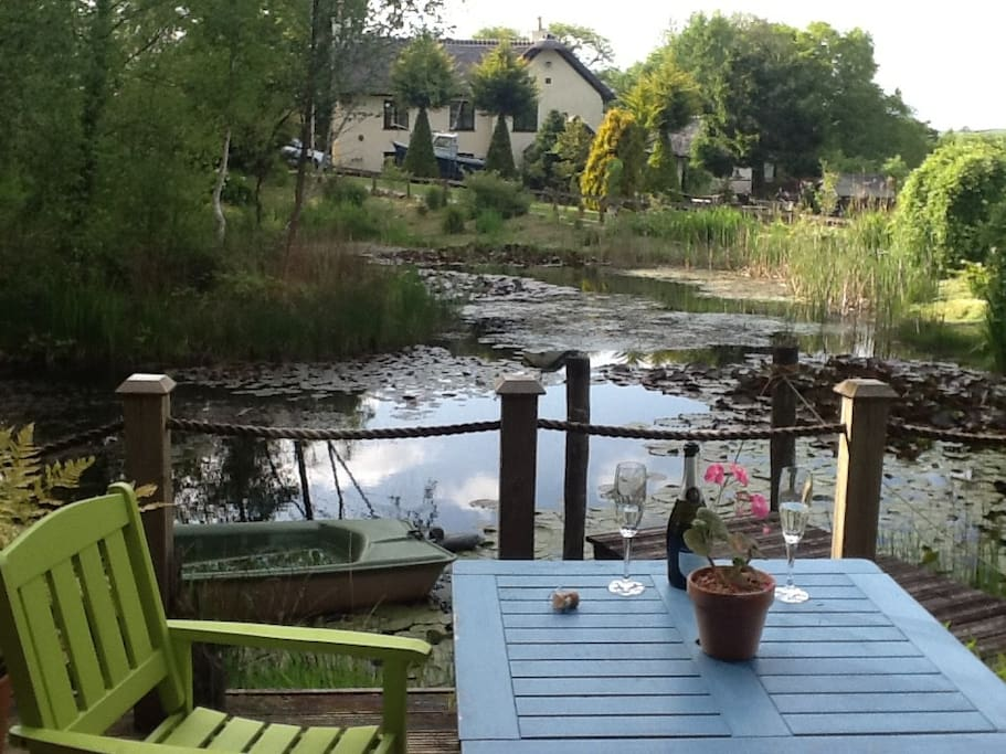 The view from the Log Cabin deck across the lily pond to our home