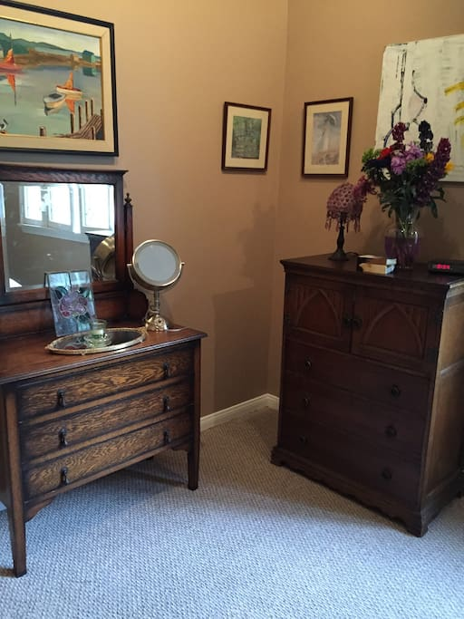 2 of the antiques dressers in bedroom
