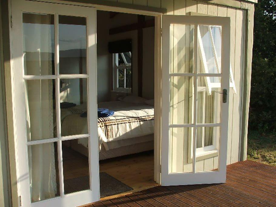Both bedrooms open onto the verandah.
