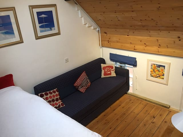 This is the lounge area which consists of raised mezzanine comfortable 5' double bed and a 6' long sofa bed that converts to two adult single beds.