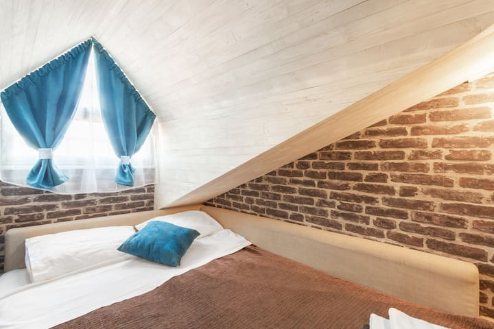 Traditional cosy loft with Double bed, cooled by fan.