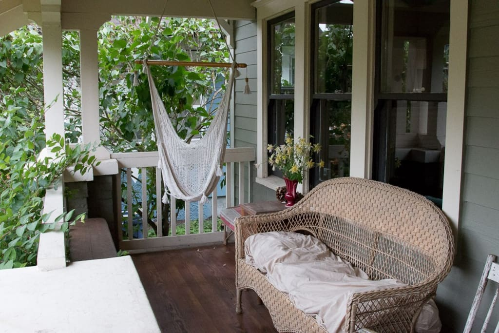 Breezy front porch with hammock chair.