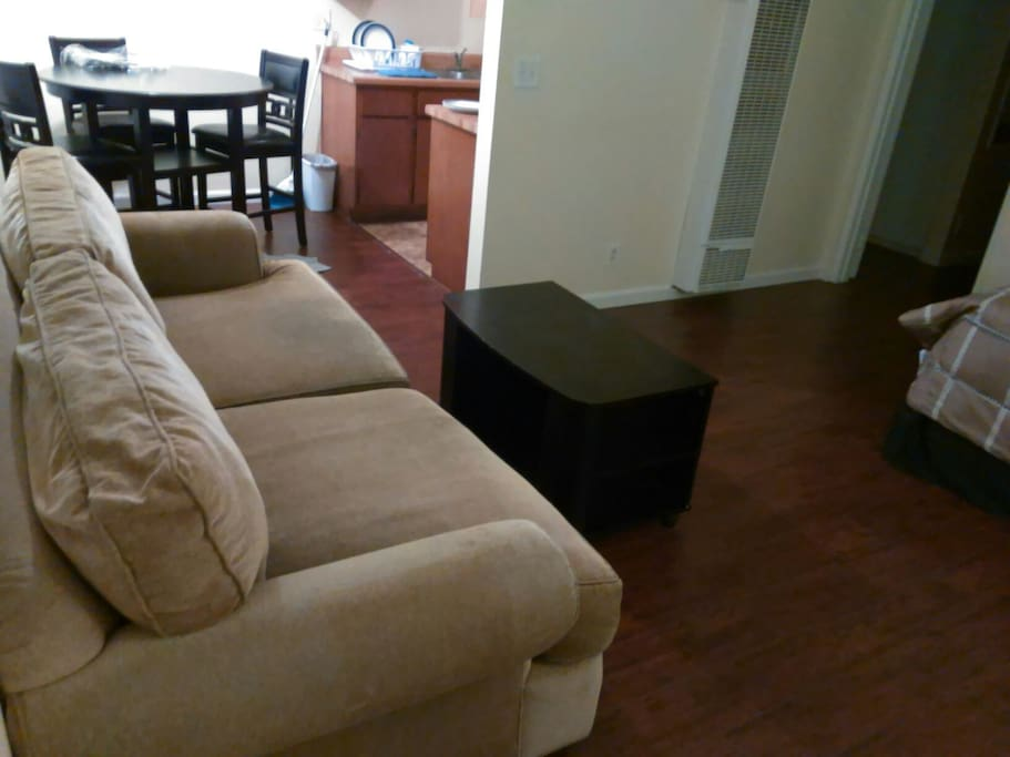 Huge Couch, Dining Room w/ Table & Chairs. Movable Coffee Table. Queen Sized Bed.