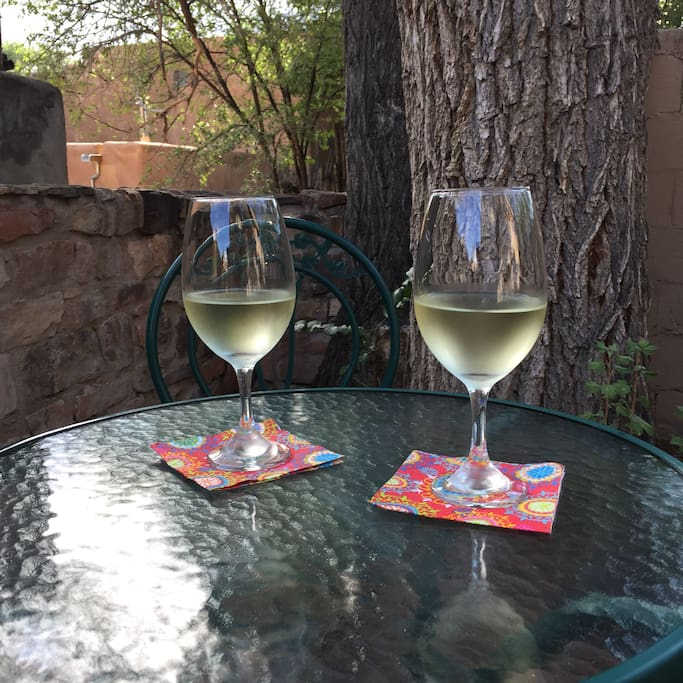 Enjoy a glass of wine in the courtyard patio
