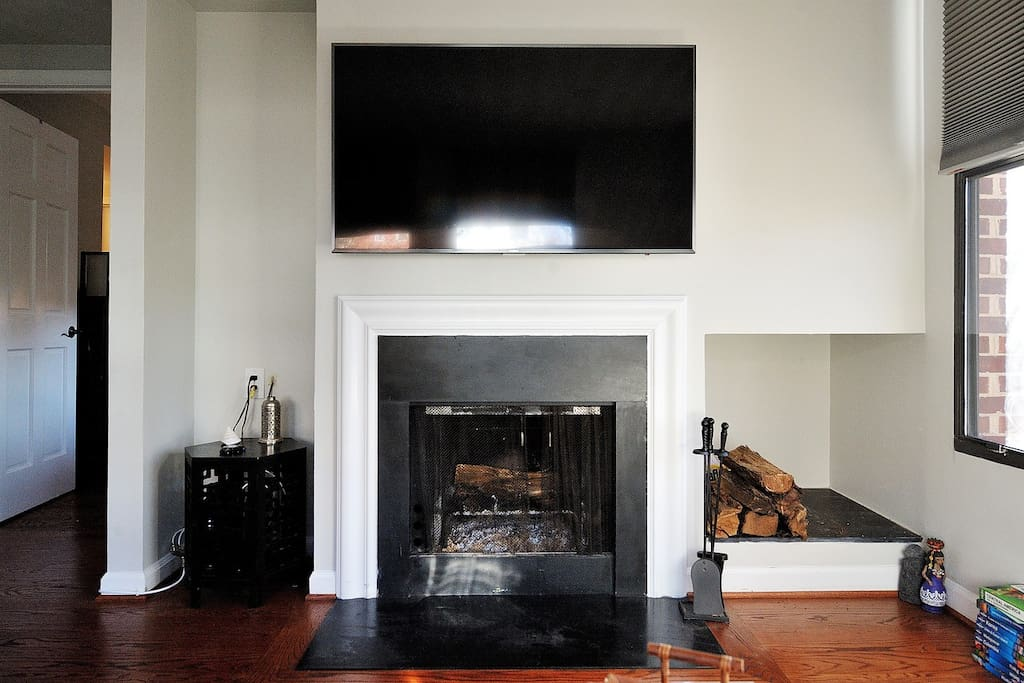 Bright, full of natural light living room with fireplace and HDTV.