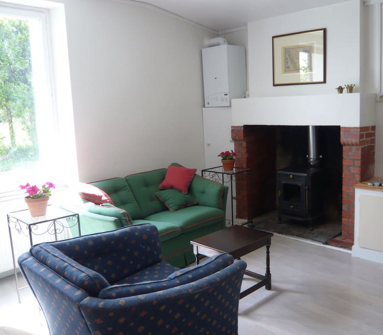 The living area has a two seater sofa and a single armchair plus low tables. There is a flat screen tv with Free Sat UK TV channels and a DVD player for when you are not relaxing in the courtyard or cooking on the barbeque.