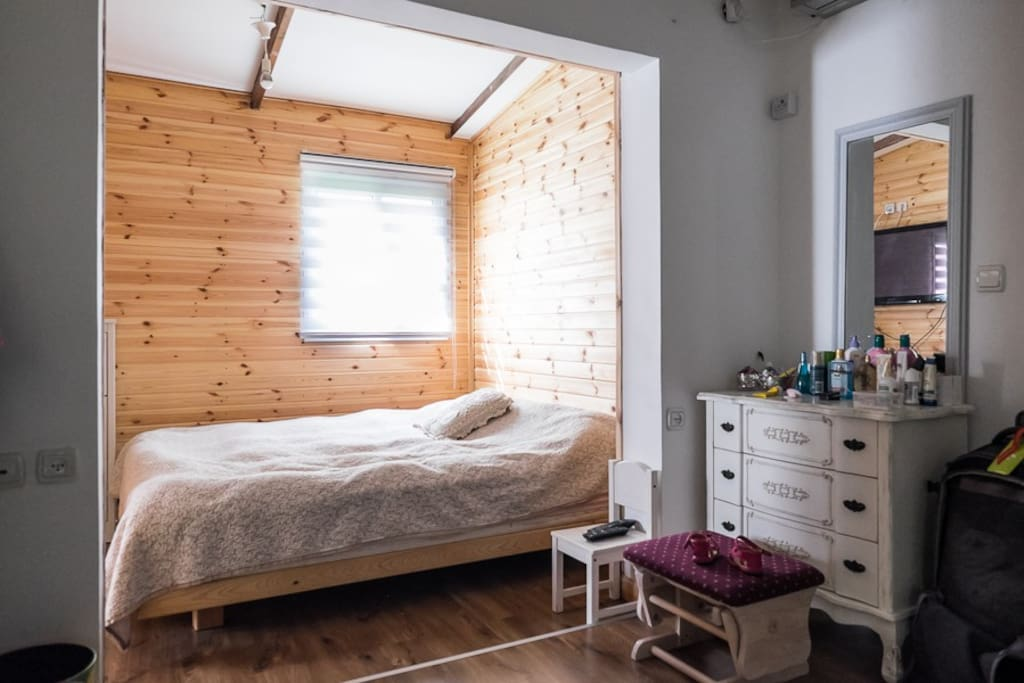 romantic and extremely large bedroom with wood covered walls.