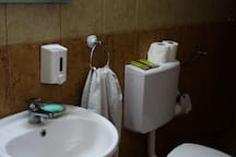 The bathroom area. The toilet is also fully equipped. The one thing we are most proud of is the hygiene, our rooms are CLEAN and smelling fresh.