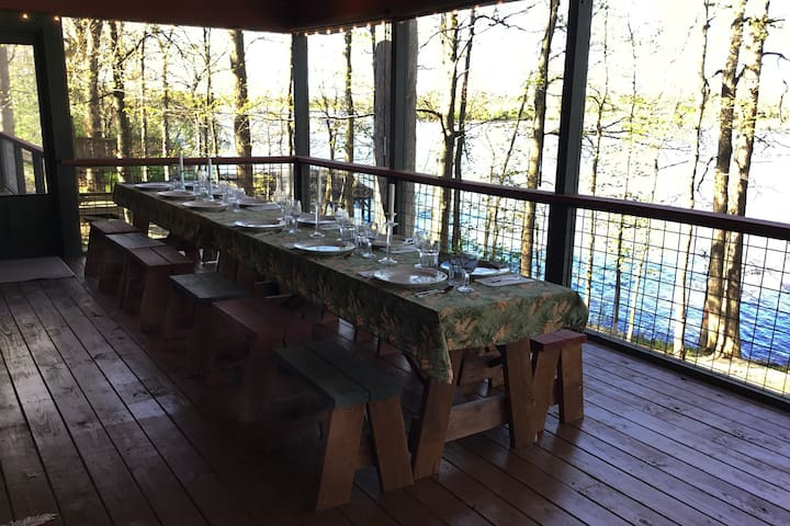 Screen porch can be set up to accommodate as many as 20 for a meal.