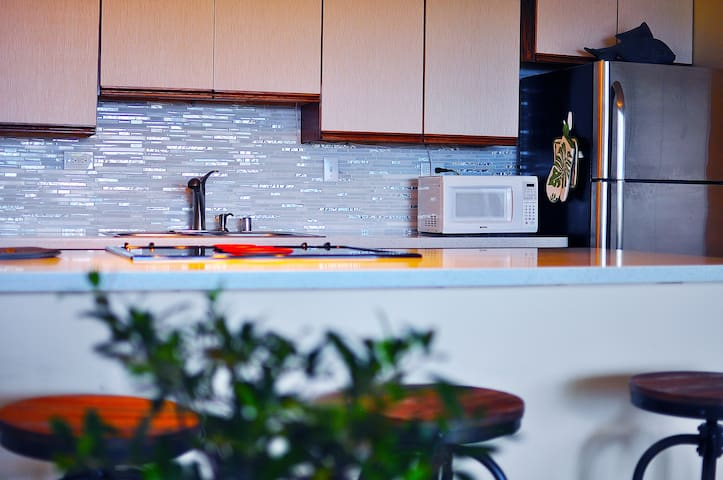 Kitchen with dishwasher and modern appliances.