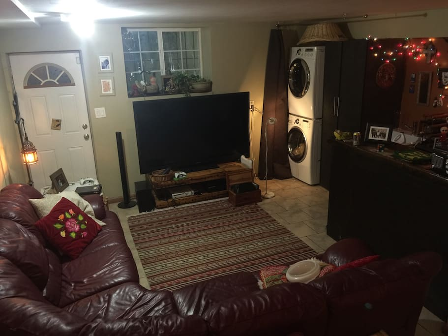 Downstairs family room with playroom, washer/dryer