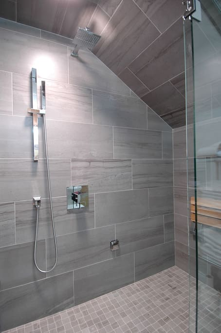 The new bath features a great steam shower with seating for two...