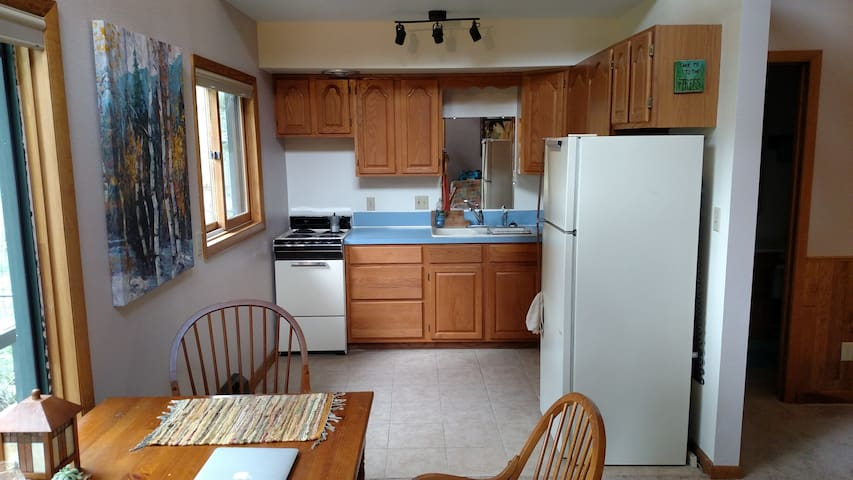 Kitchen with electric stove and refrigerator