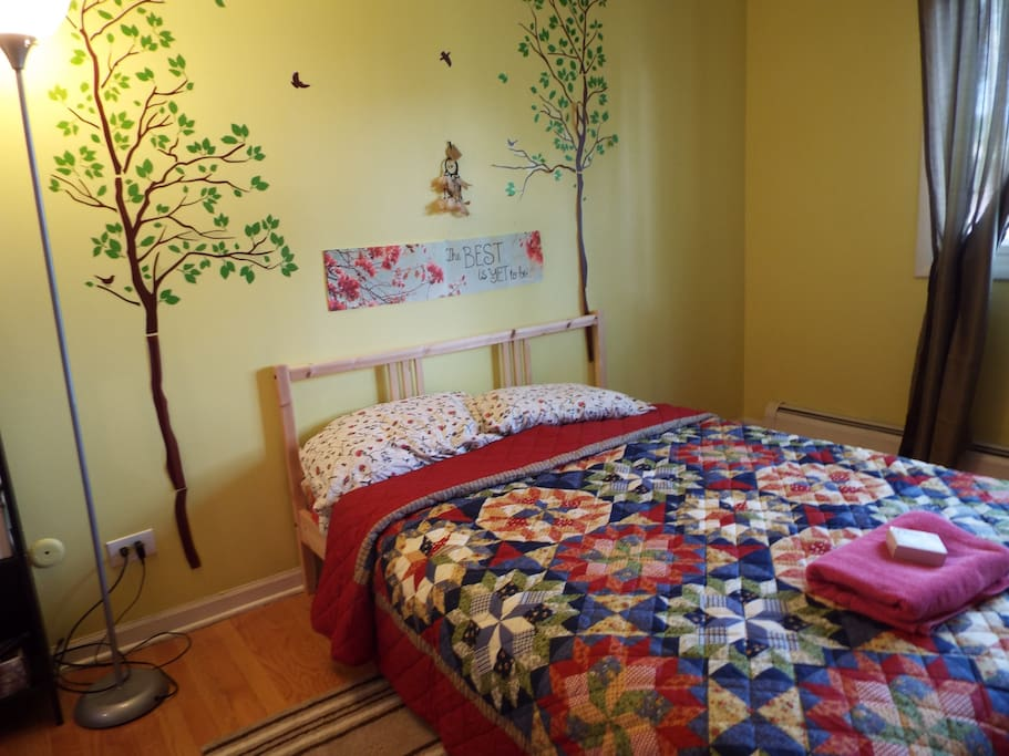 Master bedroom has a double size bed and a 1/2 bathroom