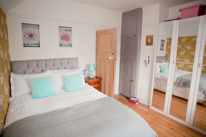 Super comfy bed with white bed linen and towels