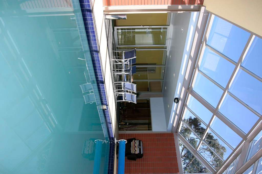 Indoor heated pool with security doors and alarm