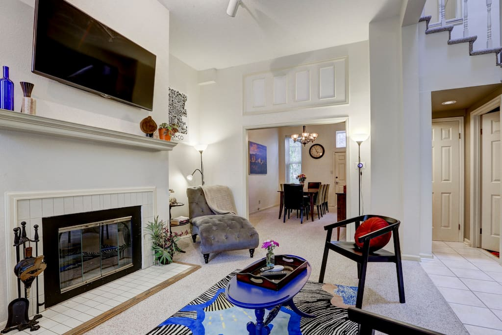 View from living room into dining room - soaring ceilings with elegant trim and moulding