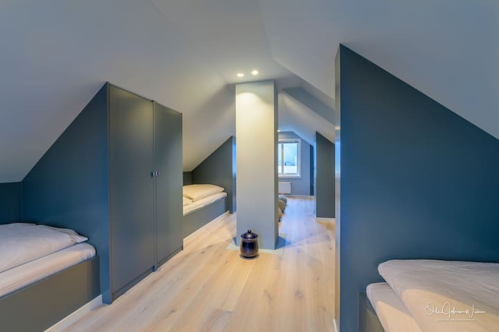 The loft has 5 separate single beds.