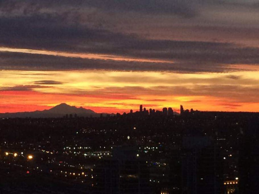 enjoy the beautiful sunrise from behind Metrotown and the Mountain Baker every morning from your bed...