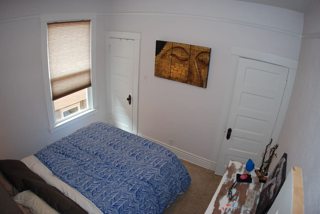 Bedroom 1 with queen bed and A/C unit in the summer.