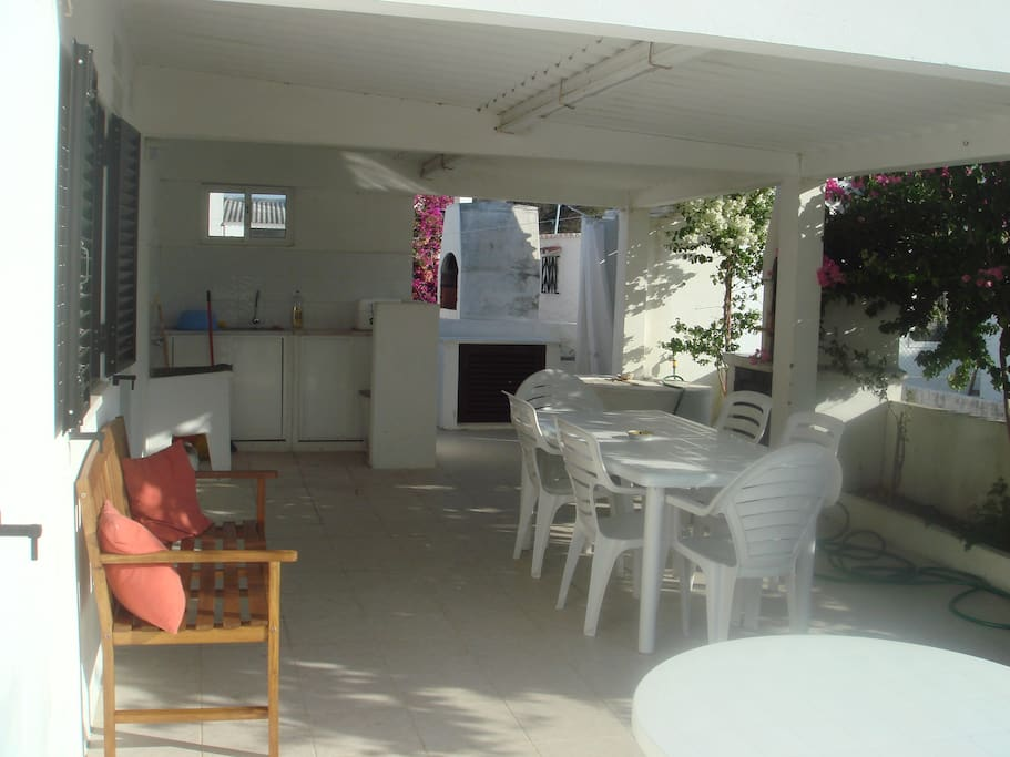 Dual aspect patio area with lounge, bbq, tables, outdoor living