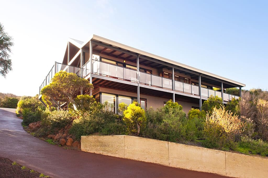 Front view of house showing wrap-around decks.