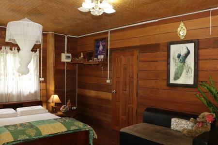Teak log cabin Doi Luang Chiangdao view