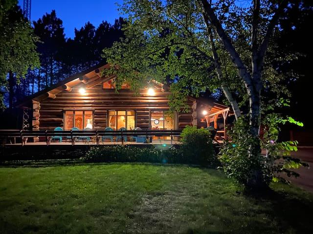 Sunset Lake Log Home Nestled in Pine Trees
