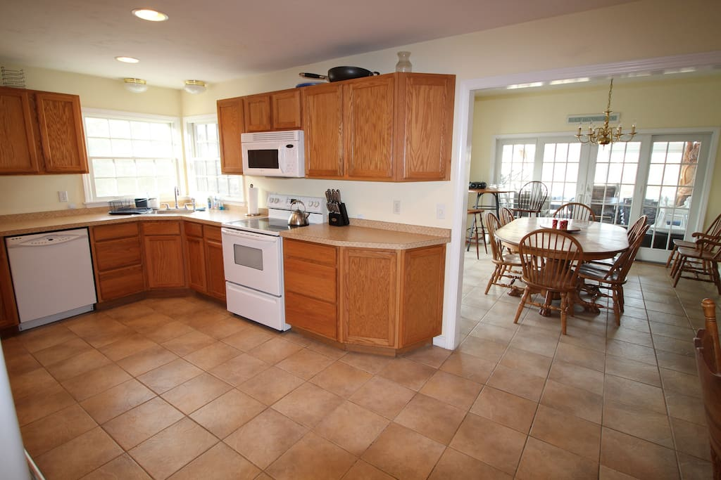 Sunny large fully equipped  kitchen with adjoining dining room
