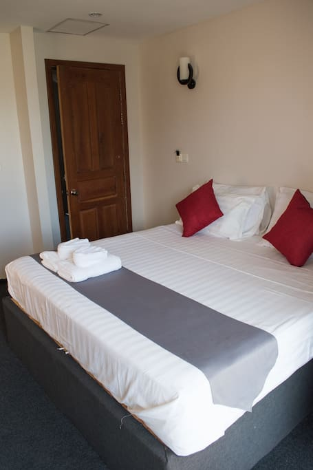 Comfy double bed for two.