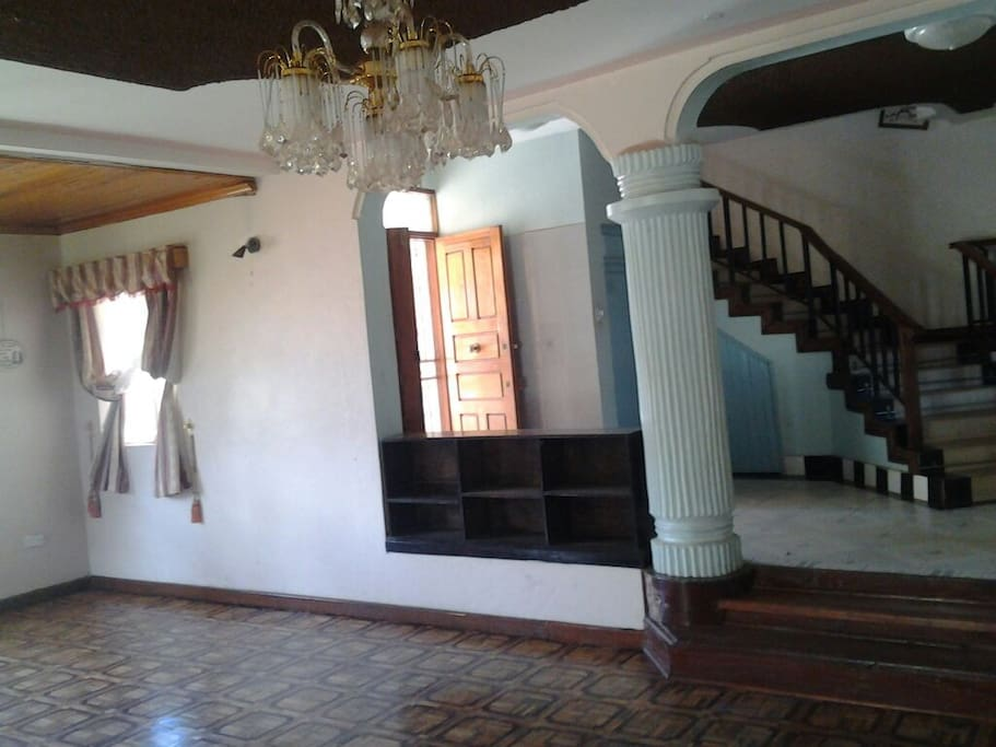 Spacious living room  with fireplace and detached dinign room