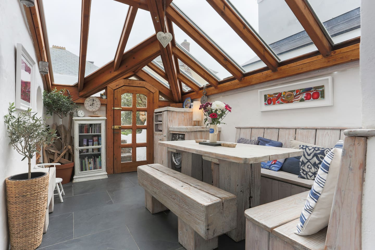 the light and sunny conservatory offers the perfect space to unwind and connect.