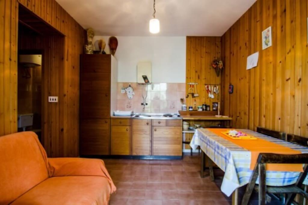 Fully equipped kitchen with an extra bed