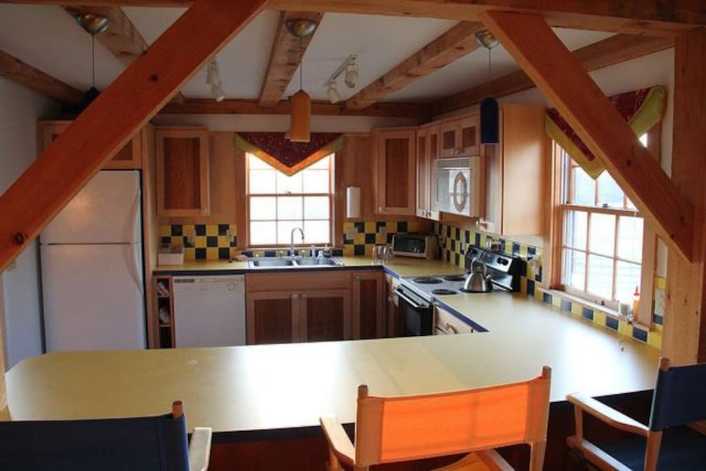 Kitchen with counter dining for three