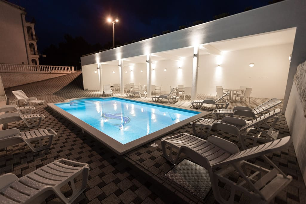 TERRACE AND HEATED, HIDRO-MASSAGED POOL IN THE EVENING