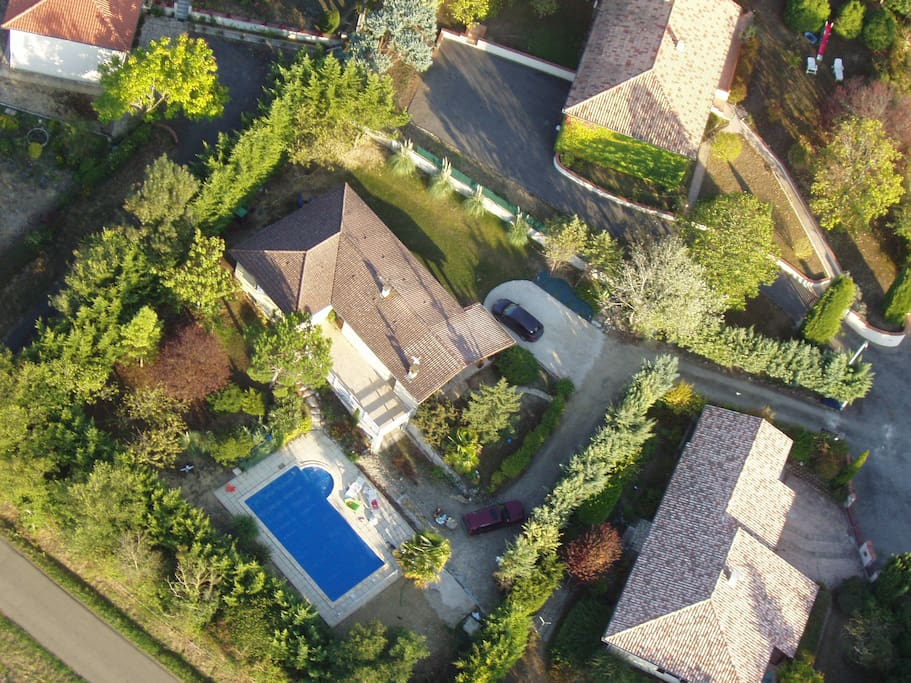 Aerial view of house, private gardens and 10m x 5m swimming pool