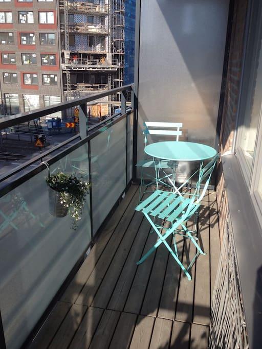Sunny balcony facing the street
