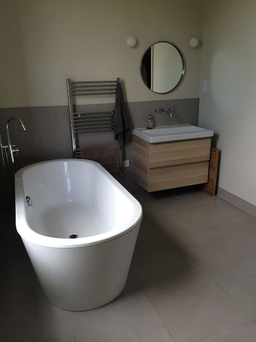 Master en suite bathroom with large shower & freestanding bath.