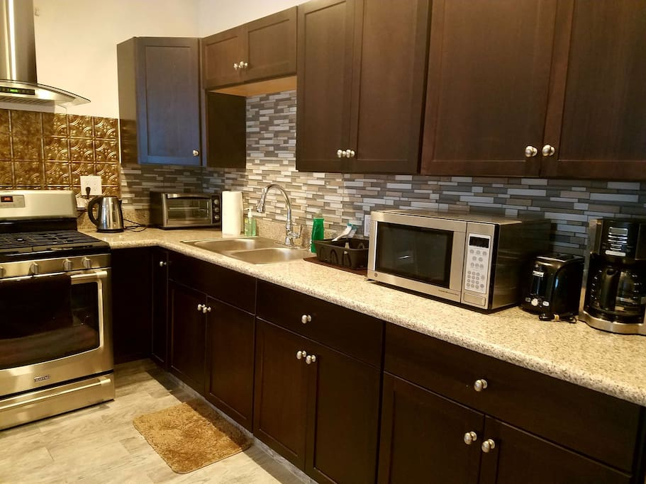 Brand new small and large appliances - microwave, toasters, electric kettle, blender, coffee maker, and more