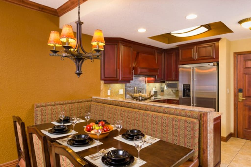 Fully equipped kitchen with the dining area. There is a dishwasher and everything you need to cook