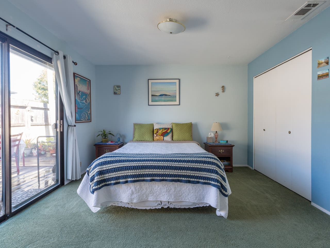 Master bedroom. Comfy queen bed with pillow top pad on top of mattress.
