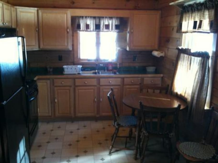 Complete Kitchen including Microwave, Oven, Stove, Refrigerator and Freezer.  Eat-in Kitchen accommodates 4.
