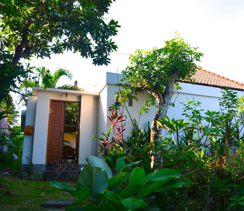 Down the end of a narrow lane opens up to this beautiful small white villa.