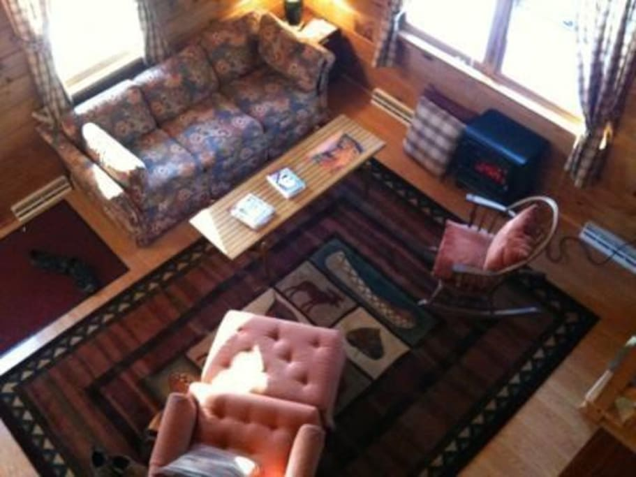 Dramatic view from loft of living room.  There are 3 twin beds and 1 large desk in the loft.  Great space for the kids!