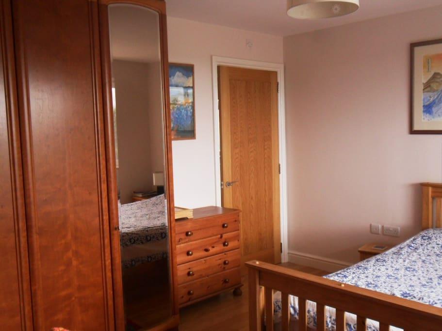 Plenty of storage space and entrance to en-suite shower room